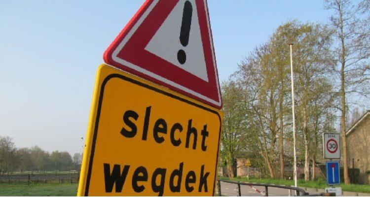 Regels aansprakelijkheid bij scootmobiel ongeluk door schade aan de weg